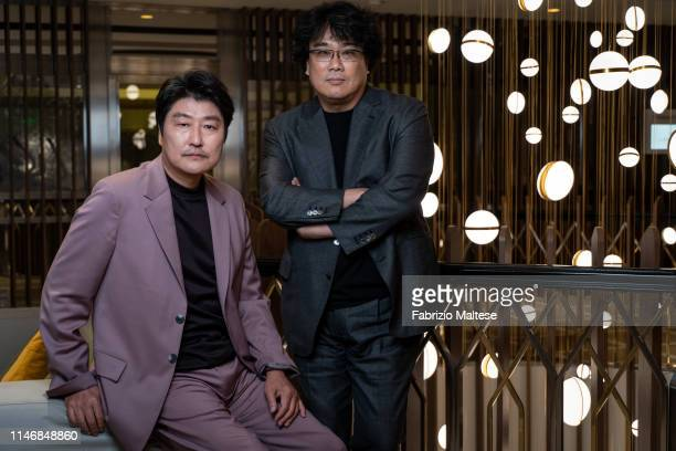 Filmmaker actor of 'Parasite' Bong Joonho Song Kangho pose for a portrait on May 20 2019 in Cannes France