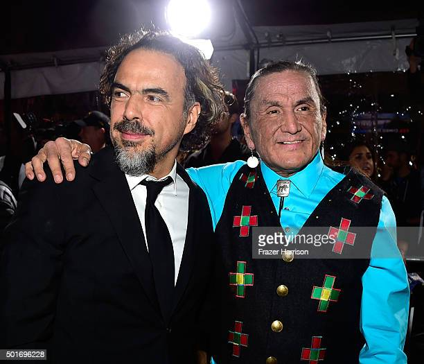 Filmmaker Alejandro Gonzalez Inarritu and actor Duane Howard attend the premiere of 20th Century Fox and Regency Enterprises' The Revenant at the TCL...