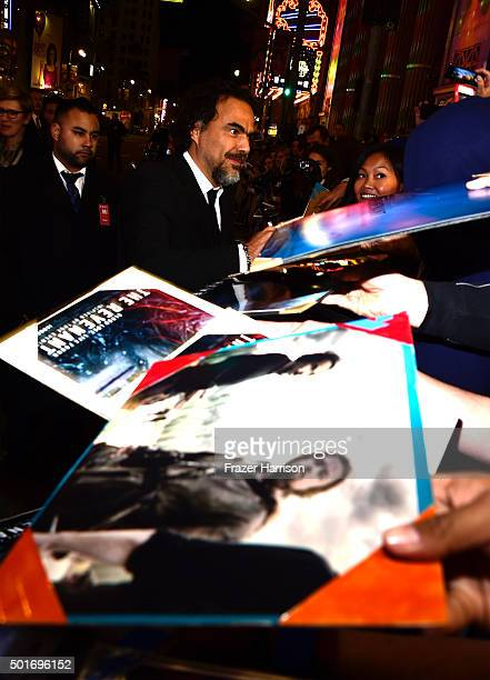 Filmmaker Alejandro Gonzalez Inarritu poses with a fan during the premiere of 20th Century Fox and Regency Enterprises' The Revenant at the TCL...