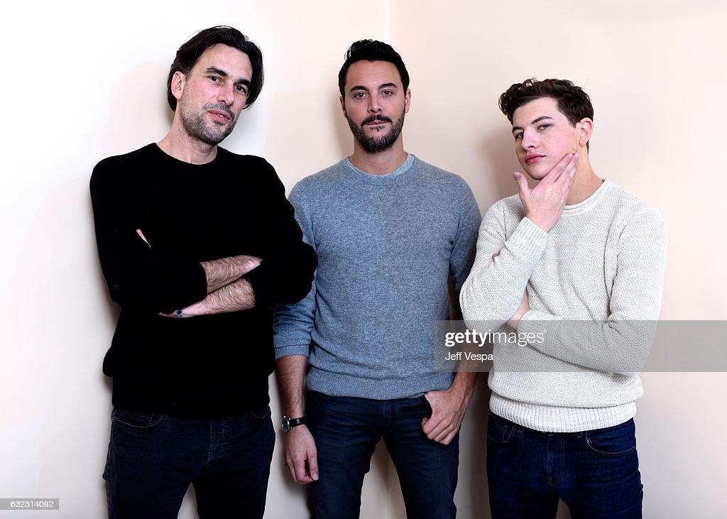 Filmmaker Alexandre Moors and actors Jack Huston and Tye Sheridan from the film 'The Yellow Birds' pose for a portrait in the WireImage Portrait Studio presented by DIRECTV during the 2017 Sundance Film Festival on January 21, 2017 in Park City, Utah.