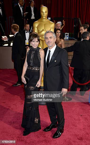 Filmmaker Alfonso Cuaron and Sheherazade Goldsmith attends the Oscars held at Hollywood Highland Center on March 2 2014 in Hollywood California