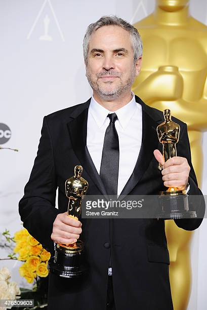 Filmmaker Alfonso Cuaron poses in the press room during the Oscars at Loews Hollywood Hotel on March 2 2014 in Hollywood California