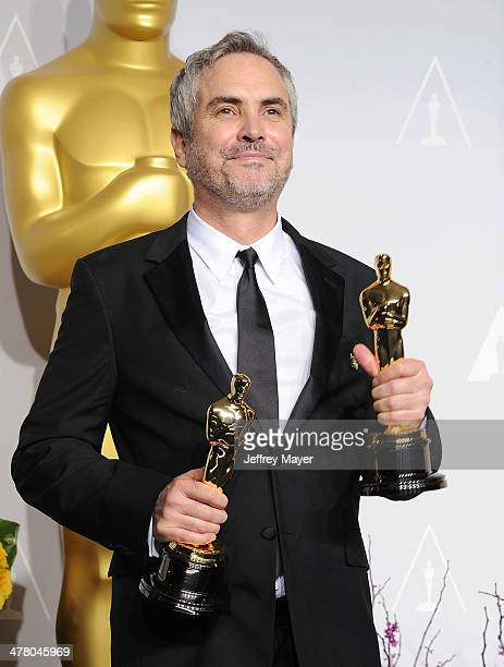 Filmmaker Alfonso Cuaron winner of Best Achievement in Directing for 'Gravity' poses in the press room during the 86th Annual Academy Awards at Loews...