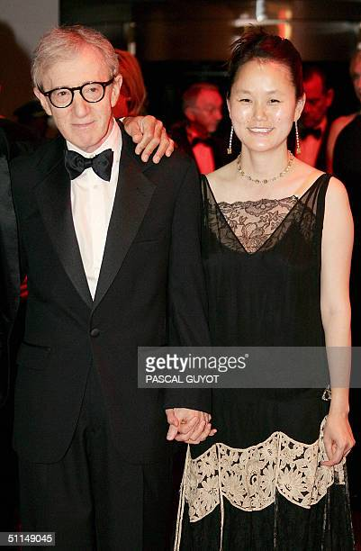 US filmmaker and actor Woody Allen and his wife SoonYi arrive 06 August 2004 to attend the annual Red Cross Ball or Bal de la CroixRouge at the...