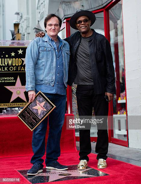 Filmmaker and Director Quentin Tarantino and actor Samuel L Jackson pose at the Hollywood Walk of Fame on December 21 2015 in Hollywood California
