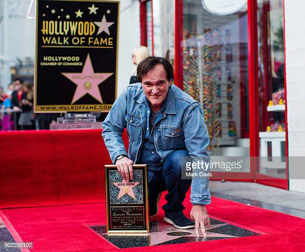Filmmaker and Director Quentin Tarantino poses with his star on the Hollywood Walk of Fame on December 21 2015 in Hollywood California