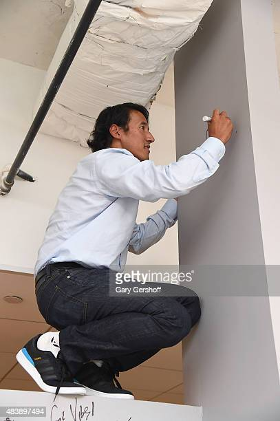 "Filmmaker and mountaineer Jimmy Chin seen drawing at AOL Build Presents: ""MERU""at AOL Studios In New York on August 13, 2015 in New York City."