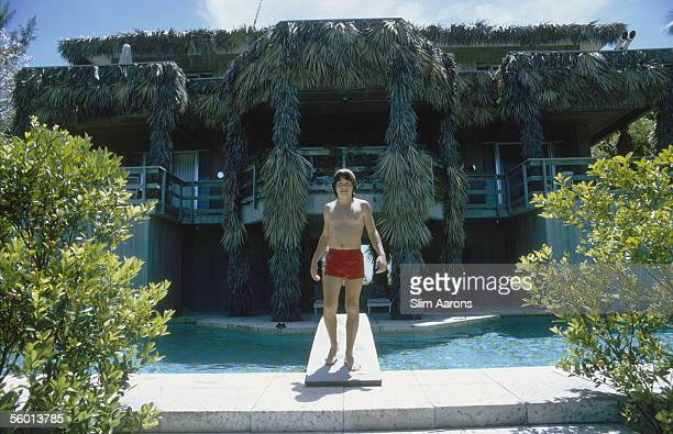 Filmmaker Anthony Radziwill makes use of the swimming pool at the Heinz House in Lyford Cay New Providence Island April 1974