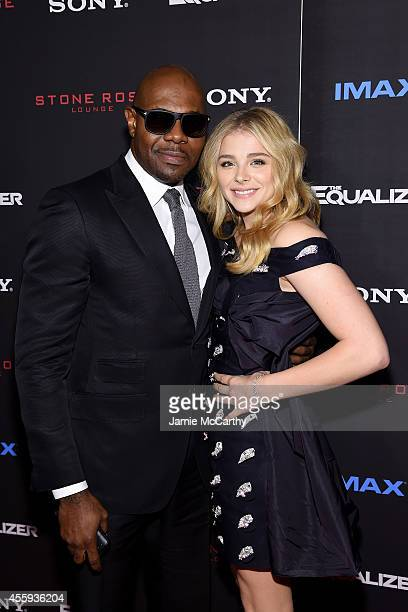 Filmmaker Antoine Fuqua and actress Chloe Grace Moretz attend the The Equalizer New York premiere at AMC Lincoln Square Theater on September 22 2014...