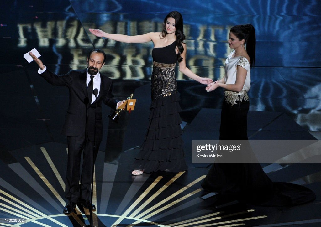 Filmmaker Asghar Farhadi (L), winner of the Best Foreign Film Award for 'A Separation,' speaks onstage during the 84th Annual Academy Awards held at the Hollywood & Highland Center on February 26, 2012 in Hollywood, California.