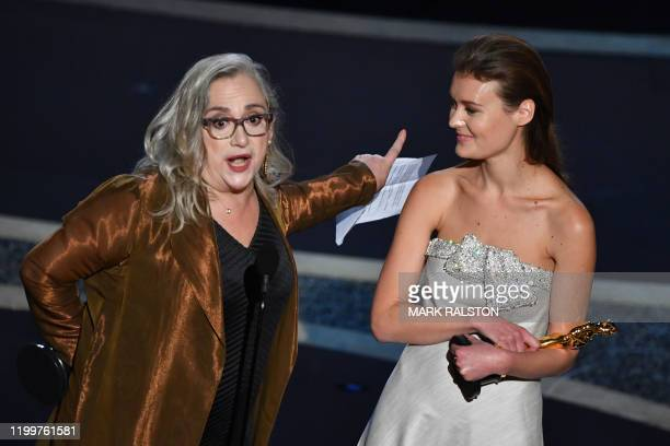 US filmmaker Carol Dysinger and director Elena Andreicheva accept the award for Best Short Subject Documentary for Learning to Skateboard in a...