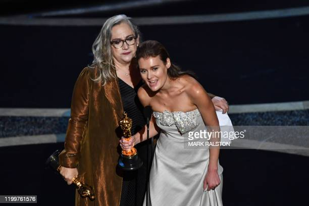 US filmmaker Carol Dysinger and director Elena Andreicheva accepts the award for Best Short Subject Documentary for Learning to Skateboard in a...