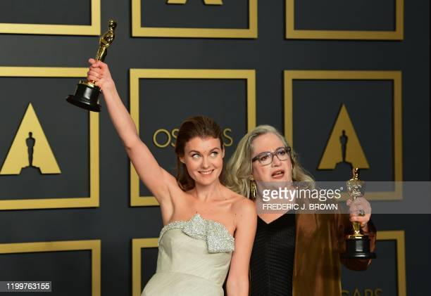 US filmmaker Carol Dysinger and director Elena Andreicheva pose in the press room with the Oscar for Best Short Subject Documentary for Learning to...