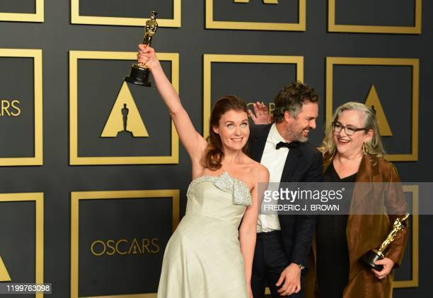 US filmmaker Carol Dysinger and director Elena Andreicheva poses in the press room with the Oscar for Best Short Subject Documentary for Learning to...