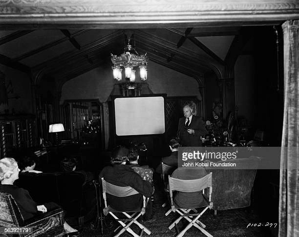 Filmmaker Cecil B DeMille and a group of people in the screening room of his home in Hollywood for Paramount Pictures 1949