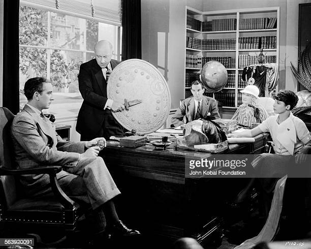 Filmmaker Cecil B DeMille and his team pictured at a story conference for the film 'Cleopatra' for Paramount Pictures 1934