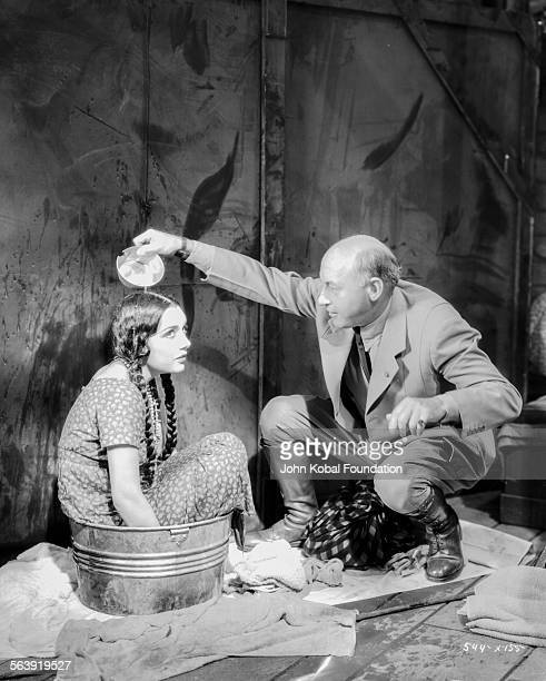 Filmmaker Cecil B DeMille pouring water over the head of an actress before a scene on the set of the film 'The Squaw Man' for MGM Studios May 12th...