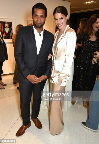 Filmmaker Damani Baker and Model Cameron Russell attend as Vogue Chopard open Glittering Prizes a photo exhibition by Ivan Shaw celebrating 70 years...