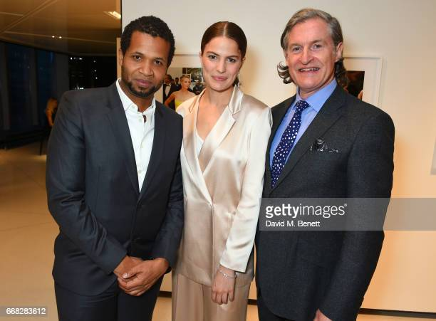 Filmmaker Damani Baker Model Cameron Russell and Executive Chairman Eco Age Ltd Iain Renwick attend as Vogue Chopard open Glittering Prizes a photo...
