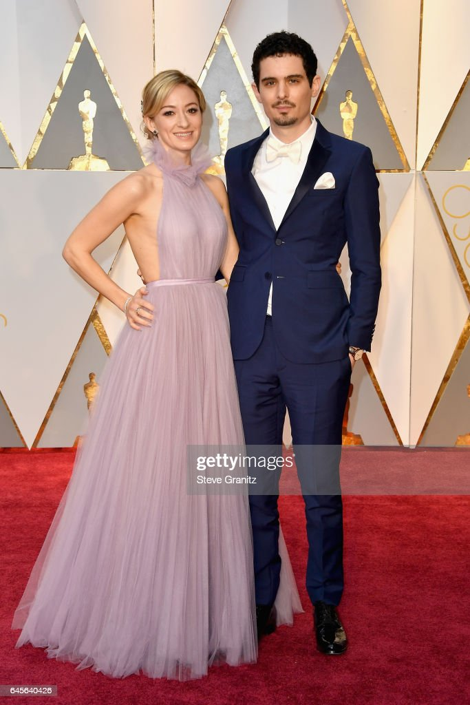 Filmmaker Damien Chazelle (R) and Olivia Hamilton attend the 89th Annual Academy Awards at Hollywood & Highland Center on February 26, 2017 in Hollywood, California.