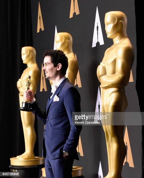 Filmmaker Damien Chazelle winner of the award for Directing for 'La La Land' poses in the press room during the 89th Annual Academy Awards at...