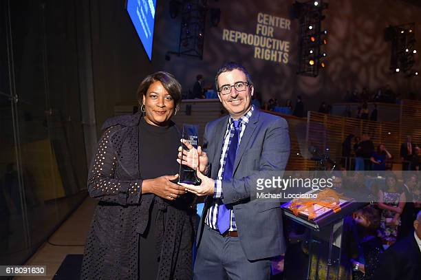 Filmmaker Dawn Porter and John Oliver pose with award onstage at The Center for Reproductive Rights 2016 Gala at the Jazz at Lincoln Center on...