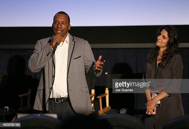 Filmmaker Deon Taylor and moderator Roya Rastegar speak onstage during the Supremacy premiere during the 2014 Los Angeles Film Festival at Regal...