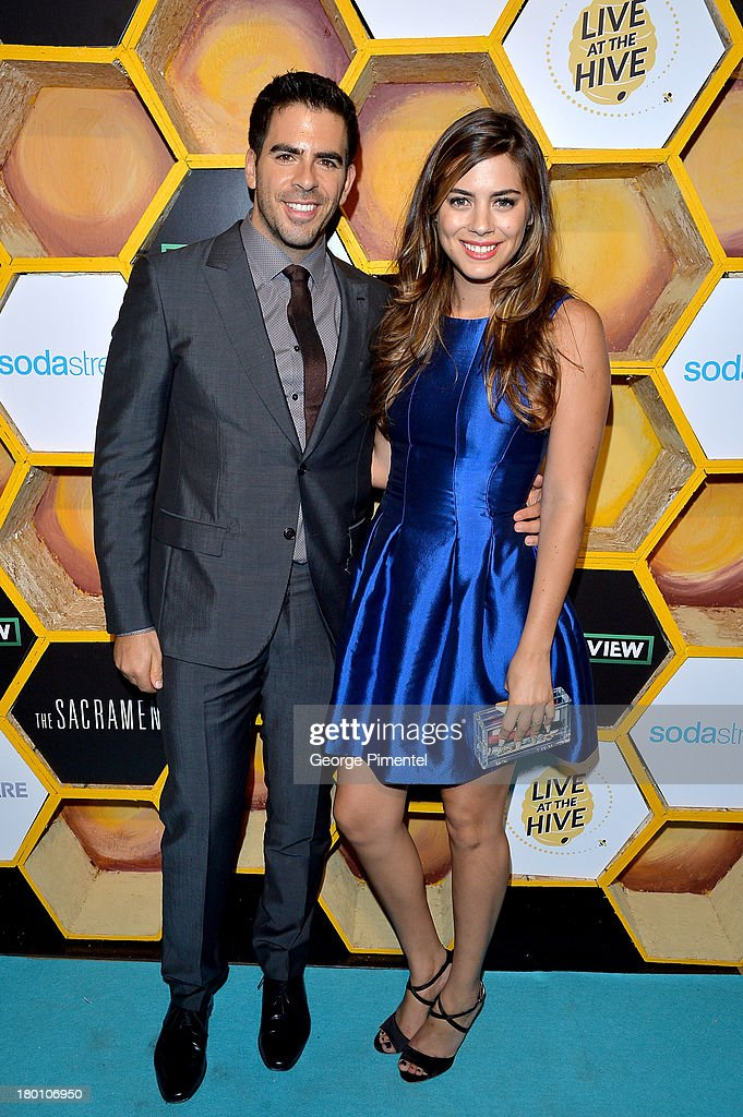 Filmmaker Eli Roth (L) and actress Lorenza Izzo attend the SodaStream presents The Worldview Party at Live at the Hive during the 2013 Toronto International Film Festival on September 8, 2013 in Toronto, Canada.