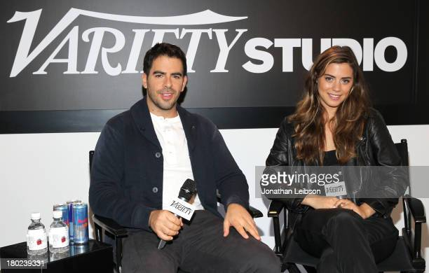 Filmmaker Eli Roth and actress Lorenza Izzo attend the Variety Studio presented by Moroccanoil at Holt Renfrew during the 2013 Toronto International...
