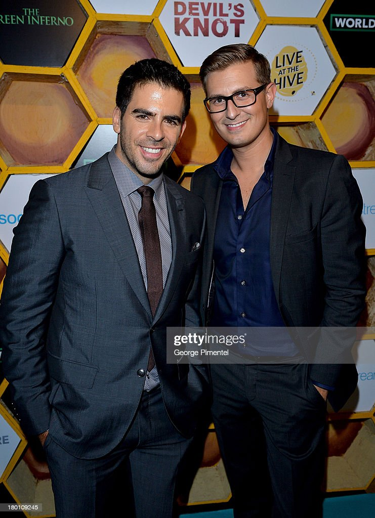 Filmmaker Eli Roth (L) and guest attend the SodaStream presents The Worldview Party at Live at the Hive during the 2013 Toronto International Film Festival on September 8, 2013 in Toronto, Canada.