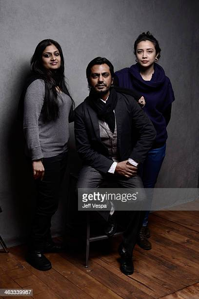 Filmmaker Geethu Mohandas actor Nawazuddin Siddiqui and actress Geetanjali Thapa pose for a portrait during the 2014 Sundance Film Festival at the...