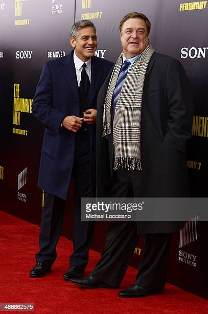Filmmaker George Clooney and actor John Goodman attend 'The Monuments Men' premiere at Ziegfeld Theater on February 4 2014 in New York City New York