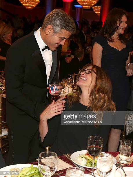 Filmmaker George Clooney and actress Julia Roberts attend the 2013 BAFTA LA Jaguar Britannia Awards presented by BBC America at The Beverly Hilton...