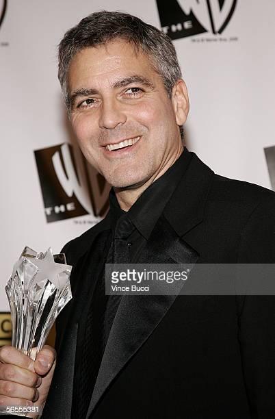 Filmmaker George Clooney poses with the Freedom Award in the press room at the 11th Annual Critics' Choice Awards held at the Santa Monica Civic...