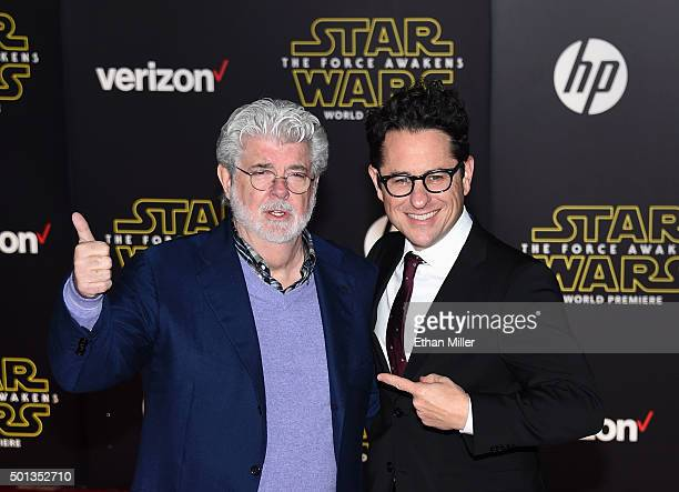 Filmmaker George Lucas and director producer and writer JJ Abrams attend the Premiere of Walt Disney Pictures and Lucasfilm's Star Wars The Force...