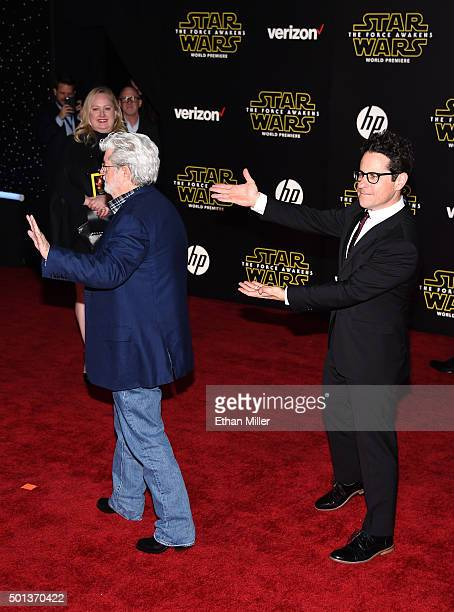Filmmaker George Lucas and director producer and writer JJ Abrams attend the Premiere of Walt Disney Pictures and Lucasfilm's 'Star Wars The Force...