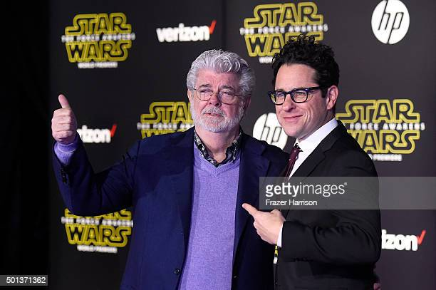 Filmmaker George Lucas and writerdirector JJ Abrams attend the Premiere of Walt Disney Pictures and Lucasfilm's Star Wars The Force Awakens on...