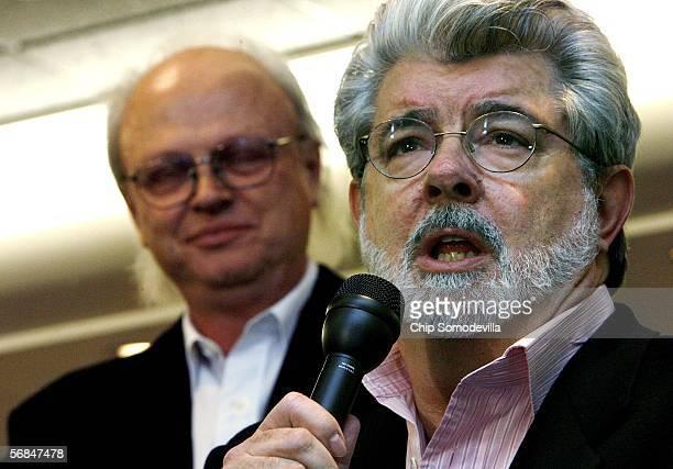 Filmmaker George Lucas speaks as Senior Visual Effects Supervisor at Industrial Light & Magic Dennis Muren listens during a town hall meeting...
