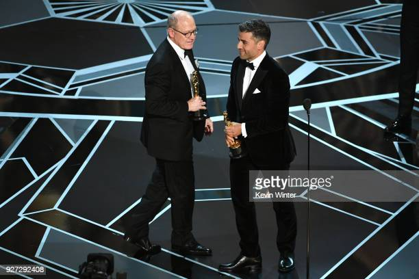 Filmmaker Glen Keane accepts Best Animated Short Film for 'Dear Basketball' from actor Oscar Isaac onstage during the 90th Annual Academy Awards at...