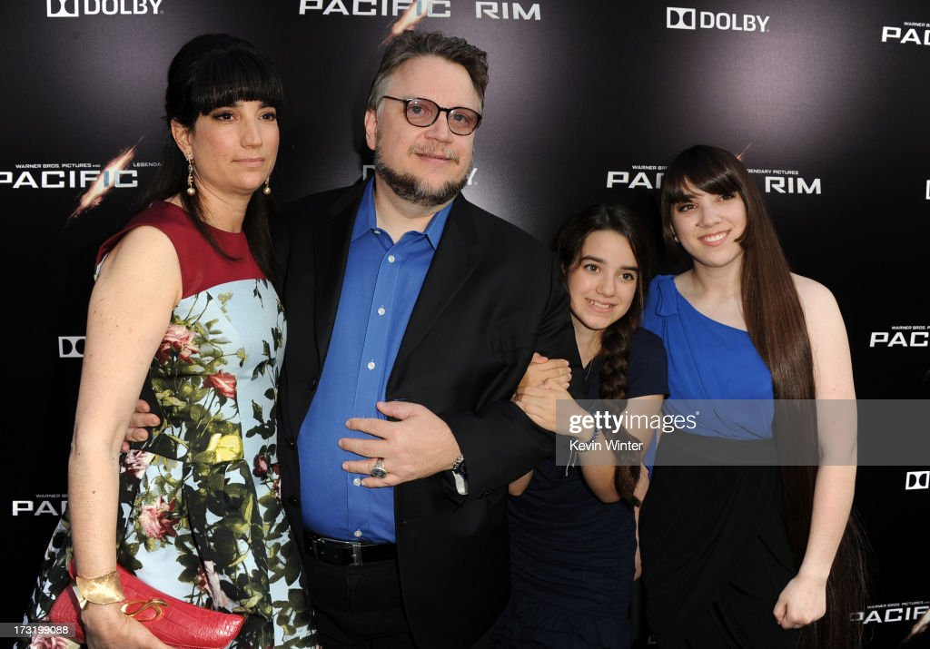 Filmmaker Guillermo del Toro (R) and Lorenza Newton with children arrive at the premiere of Warner Bros. Pictures' and Legendary Pictures' 'Pacific Rim' at Dolby Theatre on July 9, 2013 in Hollywood, California.