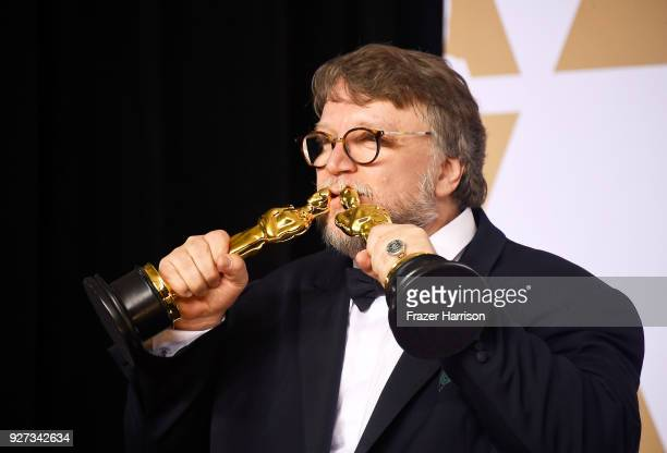 Filmmaker Guillermo del Toro winner of the Best Director and Best Picture awards for 'The Shape of Water' poses in the press room during the 90th...