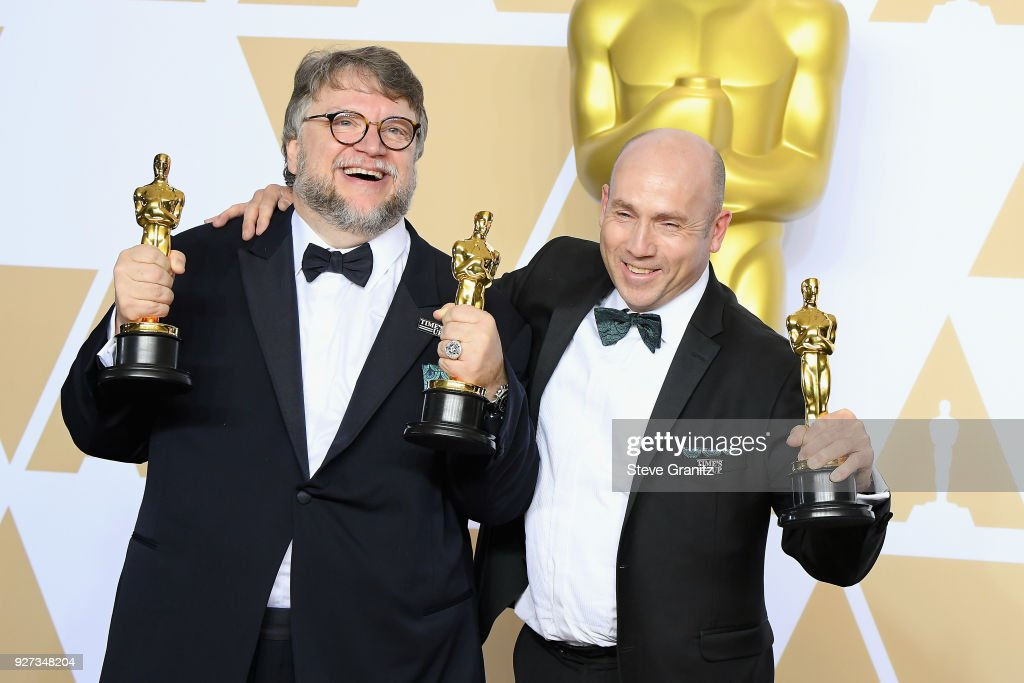 Filmmaker Guillermo del Toro (L), winner of the Best Director and Best Picture awards for 'The Shape of Water,' and producer J. Miles Dale, winner of the Best Picture award for 'The Shape of Water,' pose in the press room during the 90th Annual Academy Awards at Hollywood & Highland Center on March 4, 2018 in Hollywood, California.