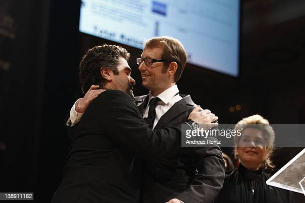 Filmmaker Joe Berlinger hugs Jason Baldwin at the Cinema for Peace Gala ceremony at the Konzerthaus Am Gendarmenmarkt during day five of the 62nd...