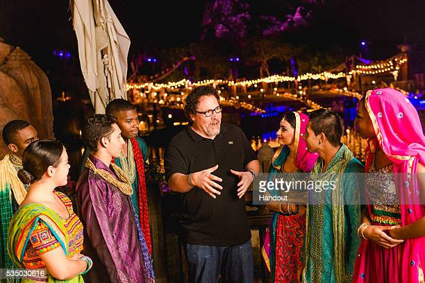 Filmmaker Jon Favreau congratulates members of the cast of The Jungle Book Alive with Magic musical during opening weekend of the new nighttime show...