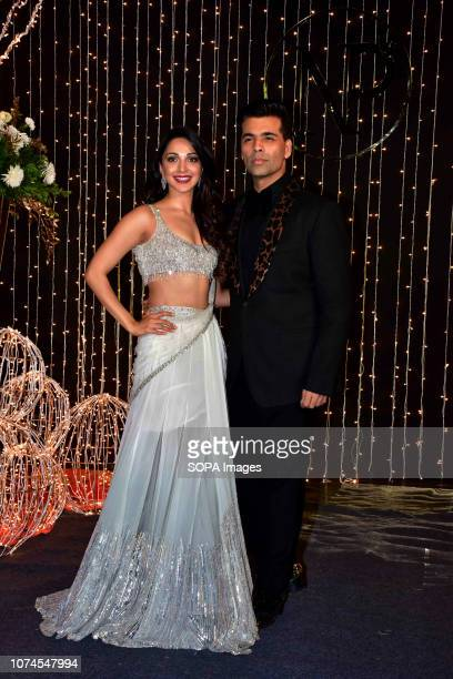 Filmmaker Karan Johar with Kiara Advani pose as they arrive to attend PriyankaNicks wedding reception at hotel Taj Lands End in Mumbai The...