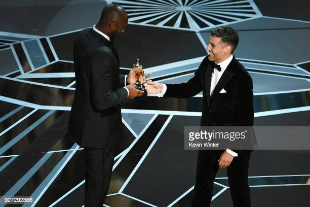 Filmmaker Kobe Bryant accepts Best Animated Short Film for 'Dear Basketball' from actor Oscar Isaac onstage during the 90th Annual Academy Awards at...