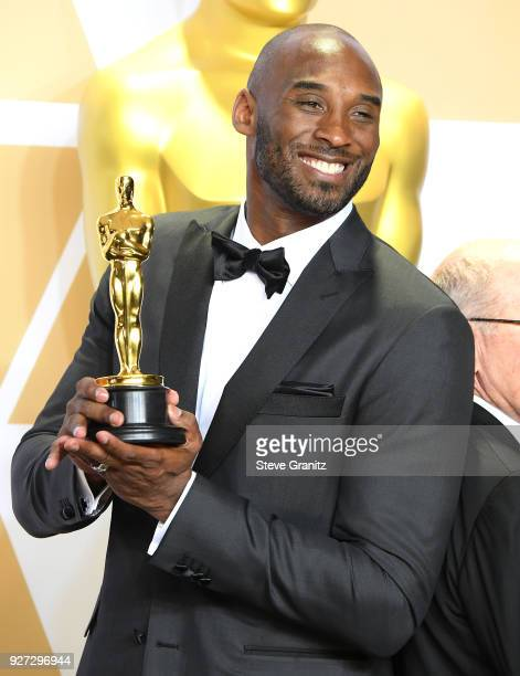"""Filmmaker Kobe Bryant, winner of the Animated Short award for """"Dear Basketball"""" poses in the press room during the 90th Annual Academy Awards at..."""