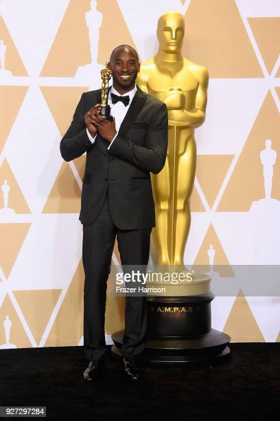 Filmmaker Kobe Bryant, winner of the Best Animated Short Film award for 'Dear Basketball,' poses in the press room during the 90th Annual Academy...