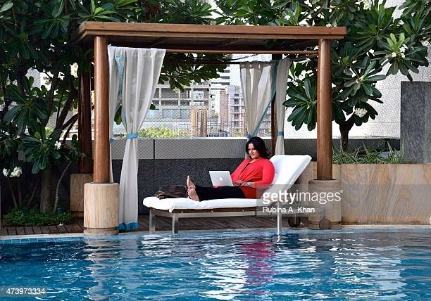 Filmmaker Leena Yadav catches a breath by the poolside at the Four Seasons Hotel on May 18, 2015 in Mumbai, India, as she works on the...