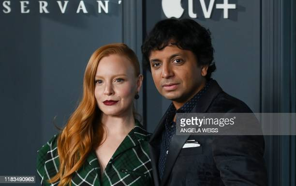 US filmmaker M Night Shyamalan and US actress Lauren Ambrose arrive for Apple TV premiere of Servant at BAM Howard Gilman Opera House in Brooklyn New...